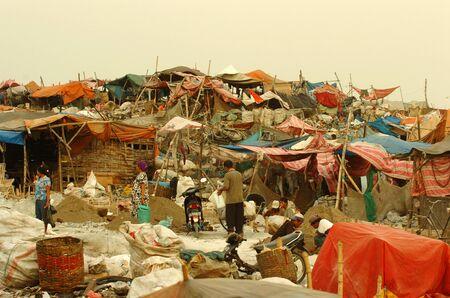 pile engine: Search trash in landfills Benowo, Surabaya, Indonesia. Photo taken on: July 20th, 2006