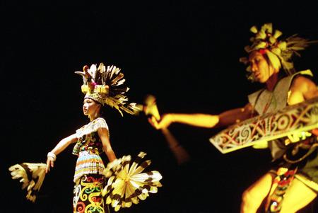 ini: Enggang dancer from Dayak tribe Kalimantan, Indonesia performents at the opera house ini Cak Durasim, Surabaya, East Java Indonesia