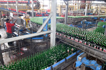 storeroom: Mojokerto, East Java, Indonesia - April 9, 2015: Production room atmosphere in PT Multi Bintang Indonesia Tbk breweries and bottling facilities in Trawas, Mojokerto, East Java, Indonesia on April 9, 2015. Indonesia has banned small retailers from selling  Editorial