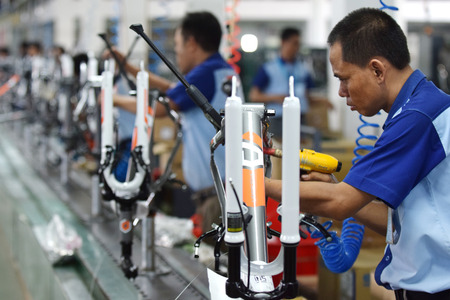 Workers check on the assembly line at the assembly bicycle bike from Indonesia Polygon in Sidoarjo East Java Indonesia thursday April 9 2015.