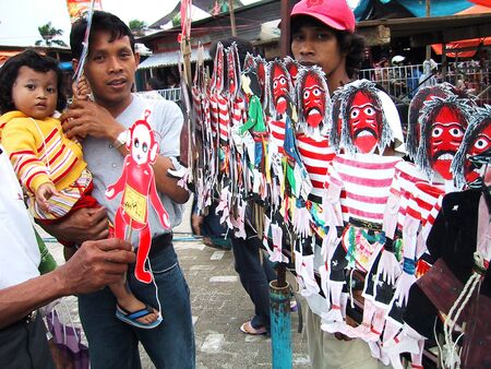 wares: A trader puppet reog offering his wares in the town square Ponorogo, East Java, Indonesia Editorial