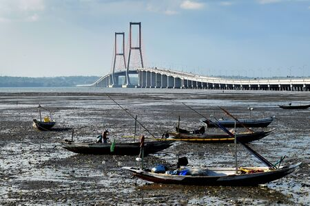 Suramadu bridge in Surabya, Indonesia with water, dry