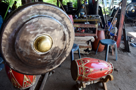 gamelan: A worker completing the manufacture gamelan at home industry in Paju village, Ponorogo, East Java, Indonesia. Editorial