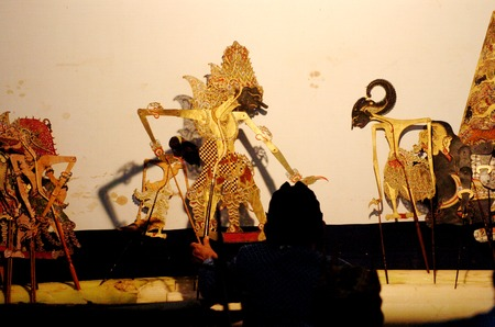 kulit: Surabaya, Indonesia - May 28, 2006: Puppet show at THR Amusement People Surabaya, East Java, Indonesia on May 28, 2006. Wayang Kulit, a highly popular shadow puppet theater, part of ancient Javanese tradition drawing huge audiences is played during ceremo Editorial