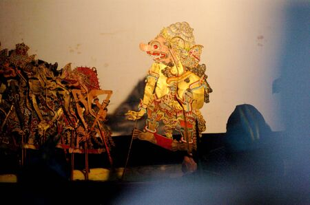wayang: Surabaya, Indonesia - May 28, 2006: Puppet show at THR Amusement People Surabaya, East Java, Indonesia on May 28, 2006. Wayang Kulit, a highly popular shadow puppet theater, part of ancient Javanese tradition drawing huge audiences is played during ceremo Editorial