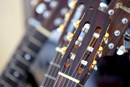 pegheads: Headstock and tuners of an acoustic guitar close up Stock Photo