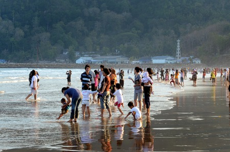 sierra: Local tourists thronged the Telengria Beach, Pacitan, Eat Java, Indonesia.