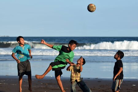 boys playing: children playing ball on the beach Papuma, Jember, East Jabva, Indonesia