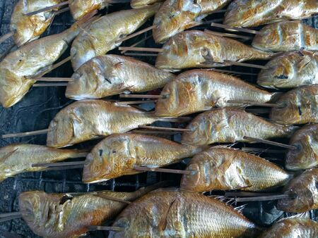 grid: Grilled fish with smoke Stock Photo