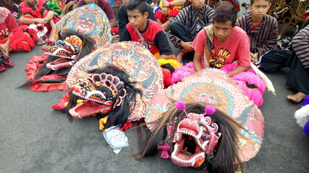 Barongan dance, javanese traditional dancers performing for cultural parade at the celebration to commemorate the 724th anniversary of Surabaya, Indonesia on May 27, 2017 Editorial