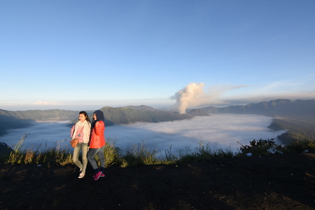 Tourists enjoy the beauty of nature on the Bromo mountain, Indonesia