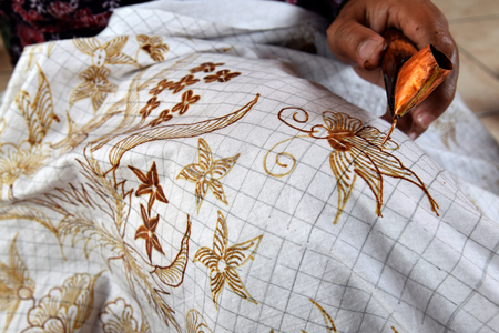 Painting watercolor on the fabric to make Batik is part of Indonesian culture Stock Photo