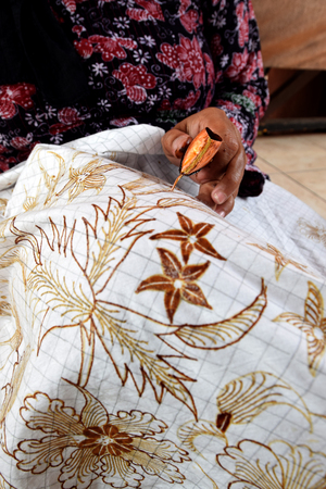 Watercolor painting on the fabric to make batik is part of Indonesian culture Stock Photo