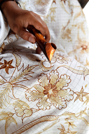 Watercolor painting on the fabric to make batik is part of Indonesian culture 写真素材