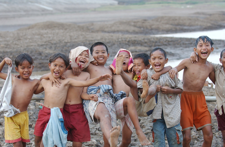 Children near the storage reservoir Dawuhan, Wonoasri, Madiun, East Java, Indonesia on August 26th, 2003