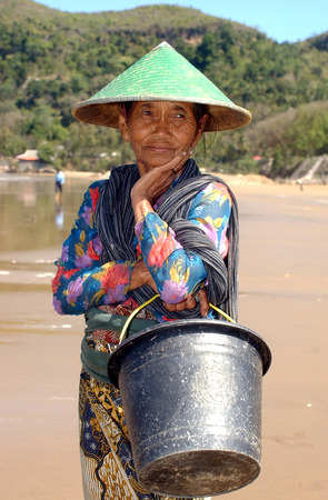 A fishermans wife awaits her husband looking for fish in the open sea at Teleng Beach, Pacitan Indonesia on July 11, 2003