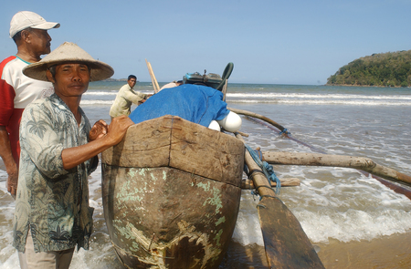 Fishermen on the Teleng beach in Pacitan, East Java, Indonesia on July 11, 2003