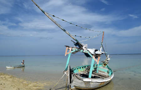 Boat at the beach with a beautiful blue background 写真素材
