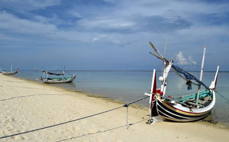 traditional boat on a beautiful beach at Gili Labak, Madura, Indonesia