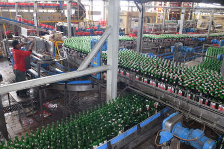 Mojokerto, East Java, Indonesia - April 9, 2015: Production room atmosphere in PT Multi Bintang Indonesia Tbk breweries and bottling facilities in Trawas, Mojokerto, East Java, Indonesia