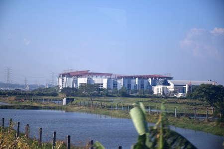 Surabaya, Indonesia July 22, 2019: Gelora Bung Tomo Stadium Surabaya, a photo taken from Gumarang Train shows the stadium area located between ponds on the outskirts of Surabaya, East Java, Indonesia