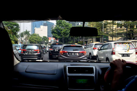 Jakarta, Indonesia - July 23, 2019: The view from a traffic jam car around the Grand Indonesia mall (Bundaran HI) Jakarta, Indonesia