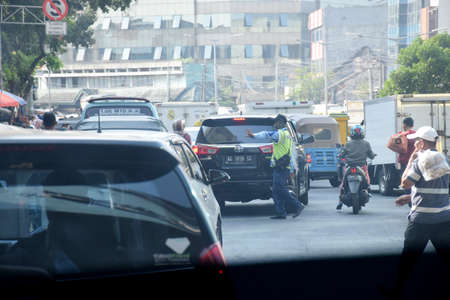 Jakarta, Indonesia - July 24, 2019: The view from a traffic jam car around the Tanah Abang Market in Jakarta, Indonesia Publikacyjne