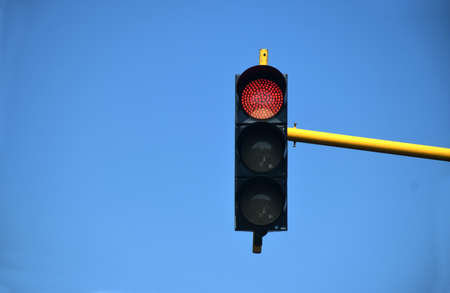 red traffic lights against the blue sky on the highway in the city of Pamekasan, Madura, Indonesia 版權商用圖片