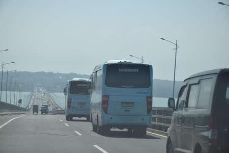 Surabaya, Indonesia - June27, 2019: The bus drove on the Suramadu bridge highway from the direction of Surabaya to Kota Bangkalan, Madura, East Java, Indonesia
