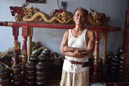 Kusnan (60) the owner of the home industry industry gamelan in Paju village, Ponorogo, East Java, Indonesia. One device gamelan they make are sold abaut USD 5,000. Photo taken on May 15, 2015. Publikacyjne