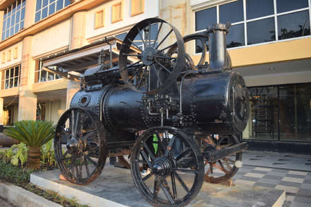An old locomotive in front of Tunjungan City, an old Dutch heritage building in the city of Surabaya, East Java, Indonesia