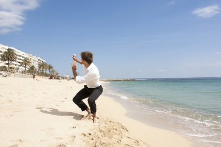 young businessman escapes from the office building to the beach
