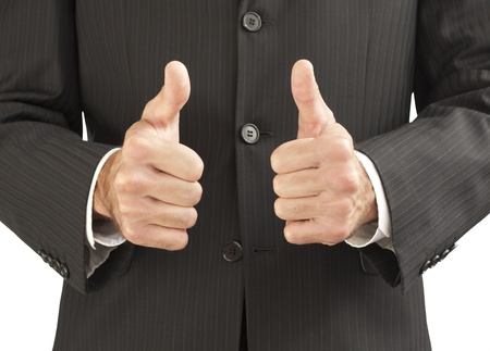 businessman in a suit showing a thumbs up gesture Фото со стока - 9449039