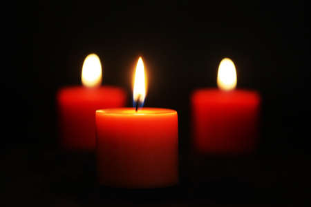 Three Red candles lit against black Stock Photo - 8852933