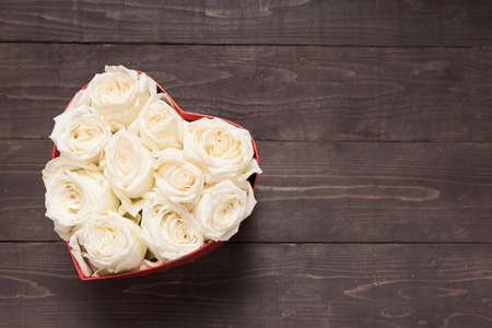spacial: White roses flower are in the heart box.
