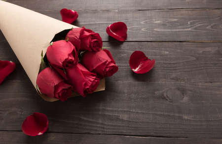 spacial: Red roses flower are on the wooden background. Stock Photo