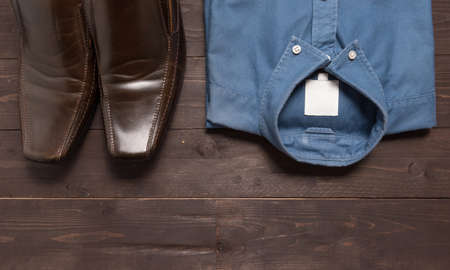 menswear: Shoes and menswear are on the wooden background. Stock Photo