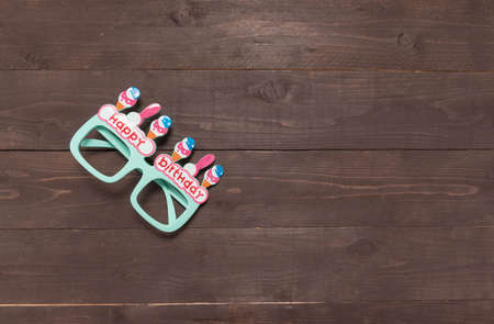 gree: Gree glasses with Happy Birthday massage is on the wooden background.  Stock Photo