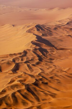 Aerial photo of red sand dunes in the Namib desert, Namibia