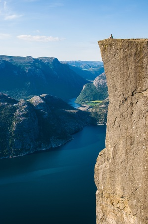 A woman enjoys the view from the Pulpit Rock, Norway