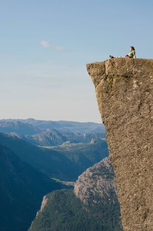 A woman enjoys the view from the Pulpit Rock, Norway  Stock Photo - 14527899
