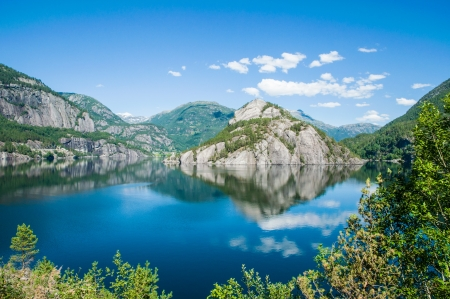 Reflections in the water of a fjord in Norway Stock Photo