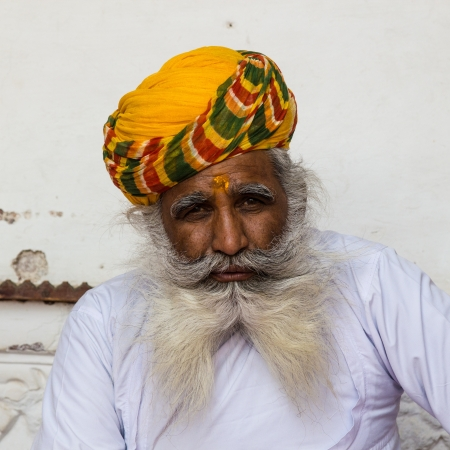 An old Indian man with a beautiful beard and yellow turban, Rajasthan, India Editorial