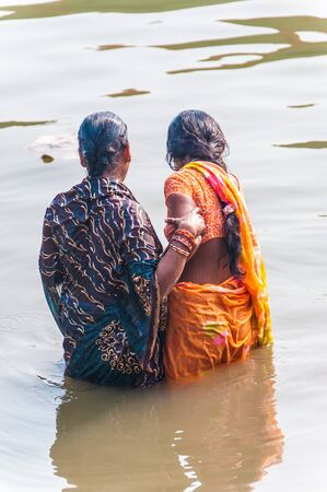 ganges: Two women take a bath in the river Ganges, Varanasi, Uttar Pradesh, India