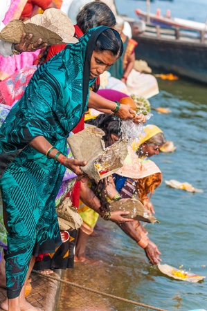 ganges: Indians celebrate a Hindu ritual in the Ganges River, Varanasi, India  Editorial