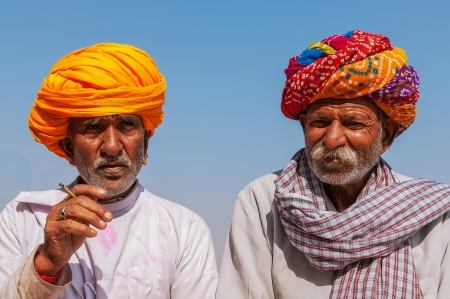 Two old Indian man with colorful turban against a blue sky, Jodhpur, Rajasthan, India