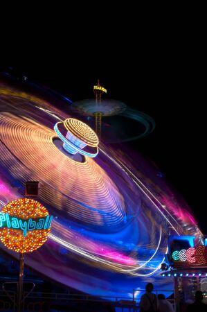 Night shots of lighted amusement rides at the Munich Oktoberfest, Munich, Germany photo