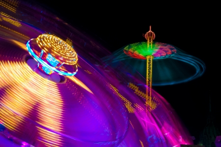 Night shots of lighted amusement rides at the Munich Oktoberfest, Munich, Germany