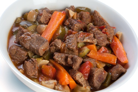 Beef stew with carrots mushrooms and courgettes Stock Photo
