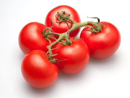 Group of five vine tomatoes Stock Photo